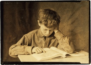 Lewis_Hine,_Boy_studying,_ca__1924